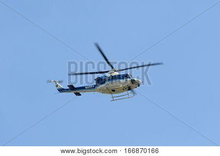 WASHINGTON DC - JUN 23, 2014: US Park Police helicopter, a Bell 412SP on the Mall of Washington, District of Columbia, USA.