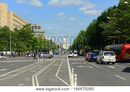 WASHINGTON DC - JUN 23, 2014: United State Capitol Building viewed from Pennsylvania Avenue in Washington, District of Columbia, USA.