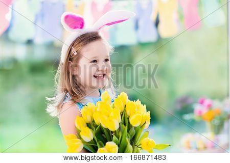 Little Girl In Bunny Ears On Easter Egg Hunt