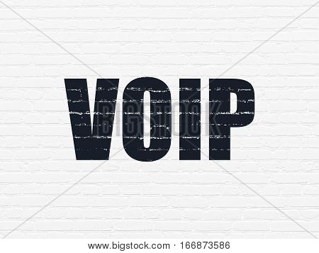 Web development concept: Painted black text VOIP on White Brick wall background