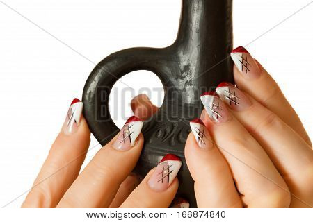 female hand with manicure holds a candlestick