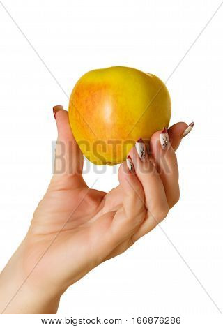 Apple in a female hand with a manicure on a white background