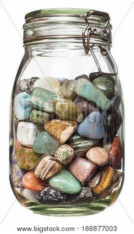 Semiprecious stones canned in glass jar, isolated on the white bacground no shadow.