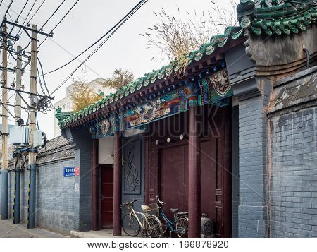 Beijing, China - Oct 30, 2016: Traditional Chinese home entrance around Dong Cheng area. Such architecture style is common in Old Beijing streets or alleys called Hutongs. This entrance is on Cuihua Hutong.