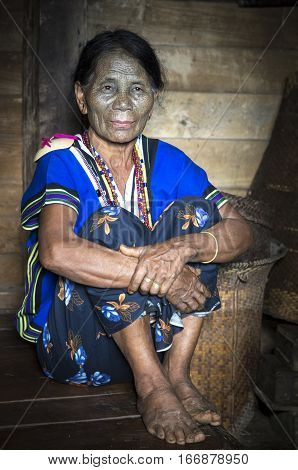 Chin region Myanmar November 11 2014: Daai tribe chin lady in her kitchen