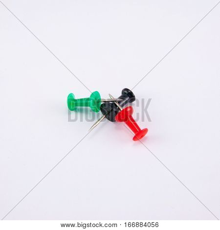 collection of various pushpins on white background. each one is shot separately