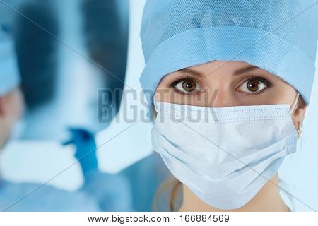 Close Up Portrait Of Young Female Surgeon Doctor