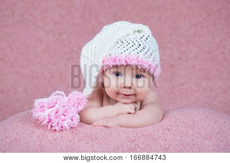Newborn baby in a warm knitted hat