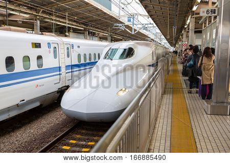 YOKOHAMA, JAPAN - NOVEMBER 7, 2016: The Shinkansen train arriving to train station in Yokohama, Japan. Shinkansen is a network of high-speed railway lines in Japan.
