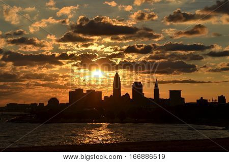 Orange Sunrise over Cleveland skyline and lake Erie