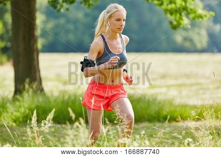 Woman training and jogging while listening to music with mp3 player