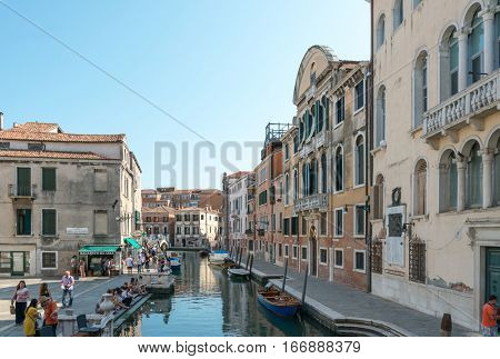 VENICE, ITALY - June 30, 2016. view of water street and old buildings in Venice on May 26, 2015. its entirety is listed as a World Heritage Site, along with its lagoon.une 30, 2016 VENICE, ITALY