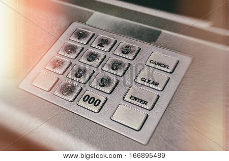 Close up ATM EPP machine keyboard or buttons of Automated Teller Machine (Cash Machine). Toned image in warm lights