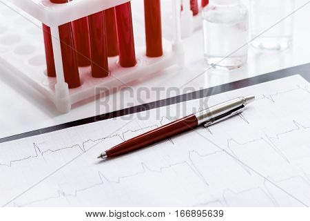 glass tubes with blood sample in stand no one on white background