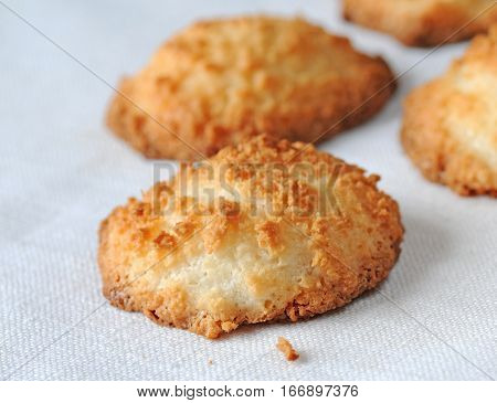 Freshly baked home made coconut macaroons or pyramids shallow depth of field