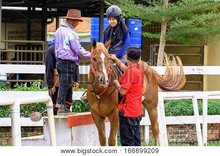 Tuaran,Sabah,Malaysia-Jan 22,2017:Visitor ready to riding a horse in Sabandar Leisure Rides,it is Sabah's attraction for lovers of the Wild West who want to experience horse riding within a paddock