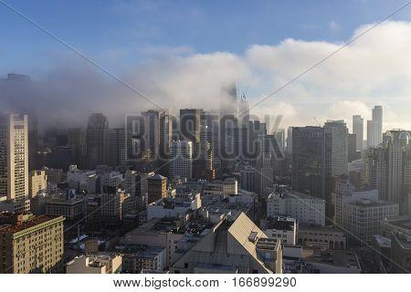 San Francisco, California, USA - January 14, 2017:  Morning fog shrouding downtown towers and San Francisco Bay.