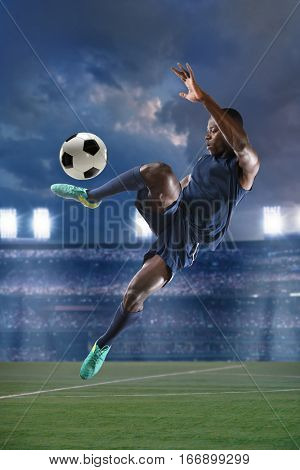 African American soccer player during match inside large stadium