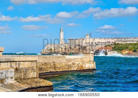 The fortress and lighthouse of El Morro and the Malecon seawall, symbols of the city of Havana in Cuba