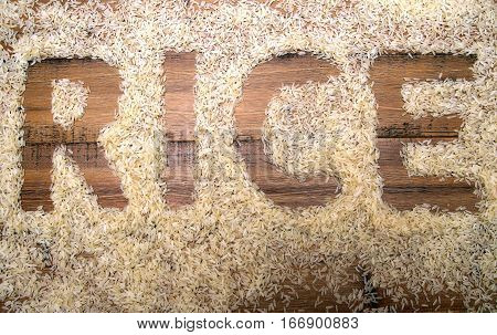 The Word Rice Written In Rice On A Wooden Background