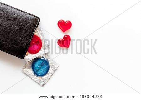 concept safe sex with condom on white background top view.