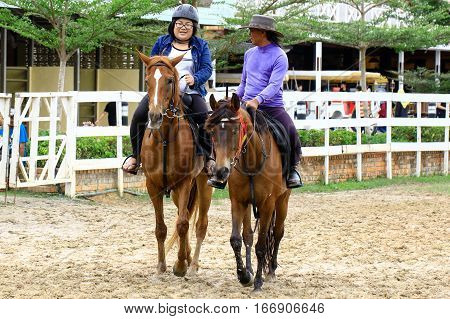 Tuaran,Sabah,Malaysia-Jan 22,2017:Visitor riding a horse in Sabandar Leisure Rides cowboy town in Tuaran,Sabah features are a 19th century American lodge,paddocks,riding trails & lots of horses.