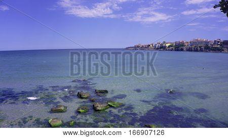 sea beach ocean travel water rock nature boat ship transport port fish trawler sky flora fauna  boats
