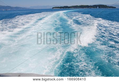 The wake from the stern of a high speed hydrofoil ferry arriving at Kerkira harbour on the Greek island of Corfu.