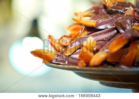 Wedges with chocolate orange in streeet market