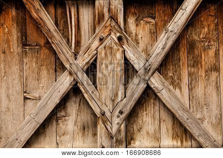 Wood background with antique tables geometric design. Wooden background. Cross and nailed wooden boards. Brown, antique wood.