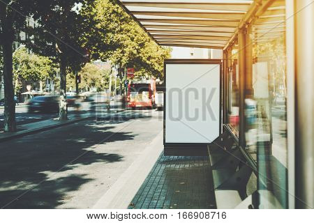 White billboard with copy space area for your text message or promotional content public information board in urban setting city bus stop with blank empty mock up banner for your advertising