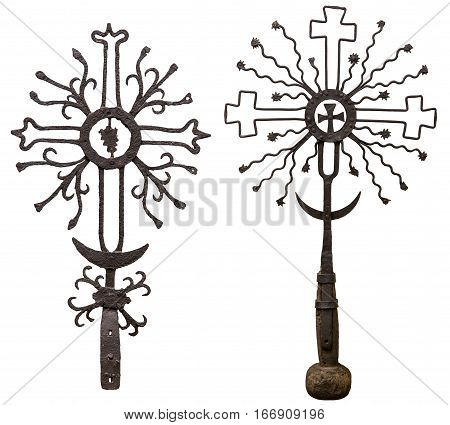 Ancient metal crosses isolated on white background. Two ancient rusty Catholic cross. Ancient forged wayside crosses. Ancient crosses made of metal, rust eating, isolated on white background.