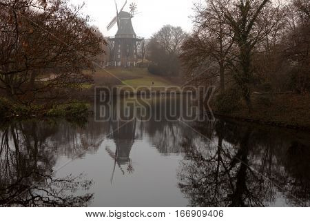 BREMEN, GERMANY - DECEMBER 31, 2016: Old windmill in Wallanlagen Park in a winter day. Dating back over a century, the windmill is open to the public and also houses a restaurant