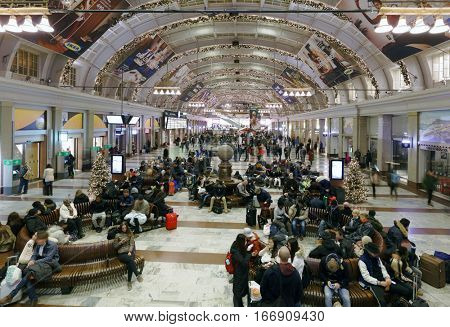 STOCKHOLM, SWEDEN - DECEMBER 26, 2016: People waiting in the Central train station. It is the largest railway station in Sweden and has over 200,000 visitors daily
