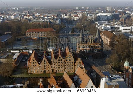 LUBECK, GERMANY - DECEMBER 30, 2016: Cityscape viewed from the tower of St. Peter church. Because of its extensive Brick Gothic architecture, the city is listed by UNESCO as a World Heritage Site