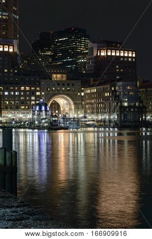 Boston Massachusetts USA - January 26, 2017: Lights from Rowes Wharf reflecting off water along Boston waterfront