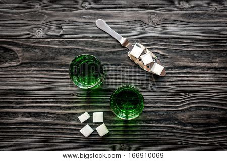 absinthe in glass on wooden background top view mock up.