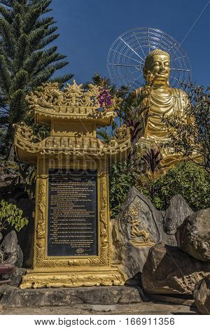 Temple and Gold statue of sitting Buddha in Da Lat city