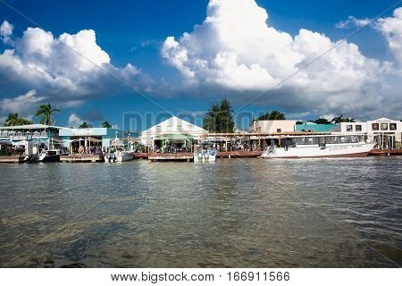 BELIZE CITY - DEC 16, 2015: Cruise ship passengers head back to the tenders by the shops at the Belize City Cruise Ship Terminal on Dec 16, 2015.