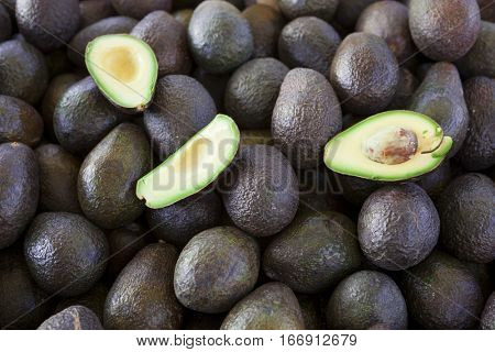 Fresh juicy fruits avocado lying on the counter. Great photo for a fruit-store