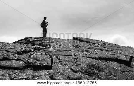 Hiker Standing Over Amazing Formation Of Magma On Lava Field