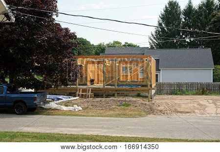 HARBOR SPRINGS, MICHIGAN / UNITED STATES - AUGUST 4, 2016: A home under construction on Fourth Street in Harbor Springs.