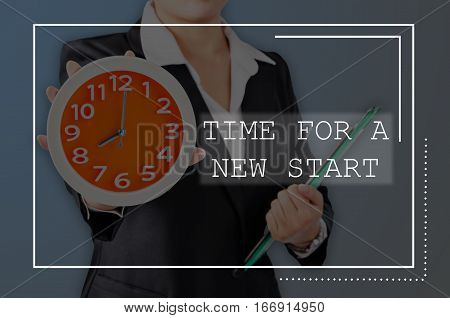 Time for a new start with Business wooman showing clock with holding document. Business concept.