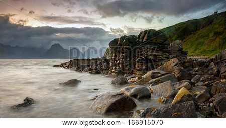 Group of stones on coast near Elgol with Cuillins Mountains in background Isle of Skye Scotland