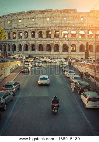 ROME - JANUARY 07: Old car and retro scooters on January 07, 2017 in Rome. Scooters are the symbol of Rome - most popular historical travel place of the Italy and the world.