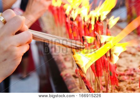 People light the candle at chinese temple