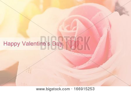 Happy valentine's day on center of rose with day light background.