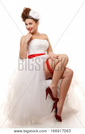 Pin-up bride sits.Professional make-up hair and style