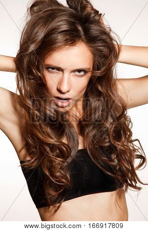 Frustrated slim sensual girl with long shiny hair