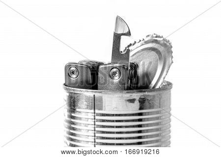 tin opener and opened tin over white background